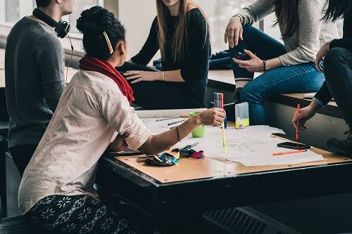 Students talking around a desk