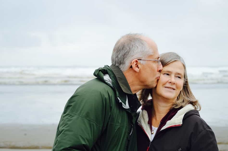 Older couple, beach, kiss, winter walk, relationship, care, loved one