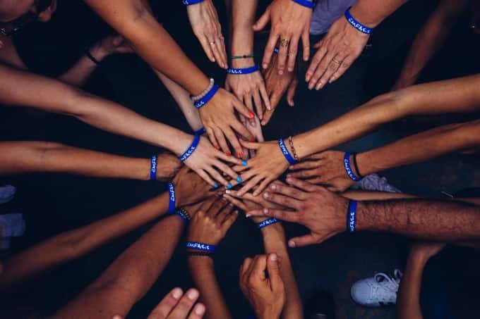 hands meeting together to show unity